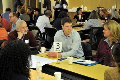 Faculty in discussion at 4CAST event