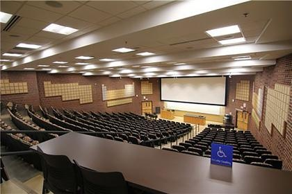 Photo of large empty lecture hall.