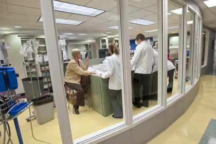 Photo of pharmacy students in a laboratory setting.