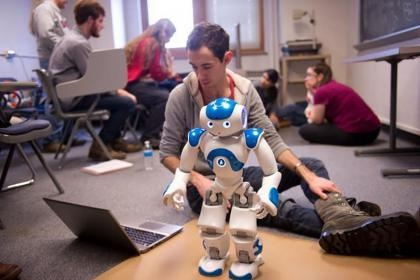 Image of students working on the dancing robots project.