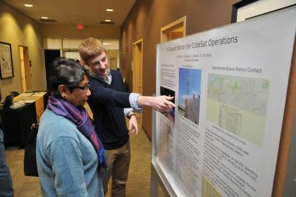 Student discusses research findings with faculty.