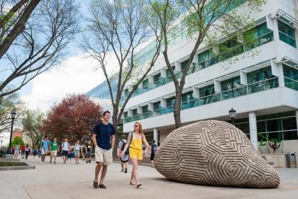 Photo of students walking through the Anne Cleary Walkway.