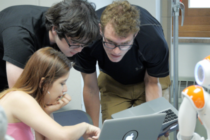 Photo of students working on laptops in class.