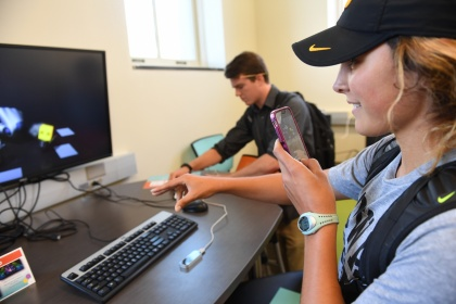 Student using technology on campus