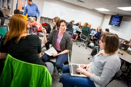 Image of students discussing assignments in small groups.