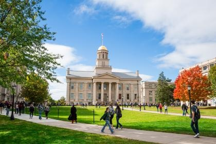 Photo of students walking through the University of Iowa Pentacrest.